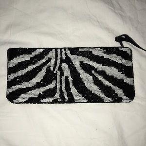 Zebra beaded clutch made by Cache